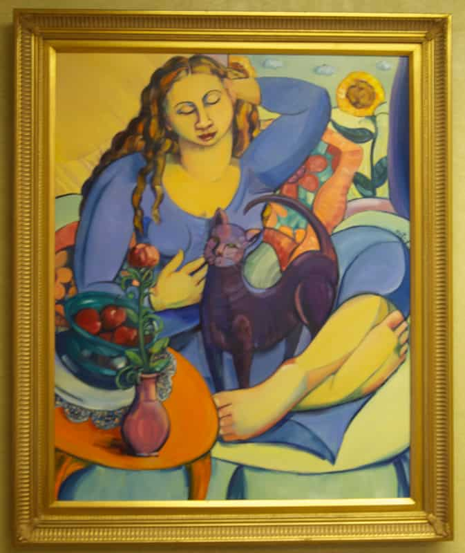 A painting of a woman and a cat