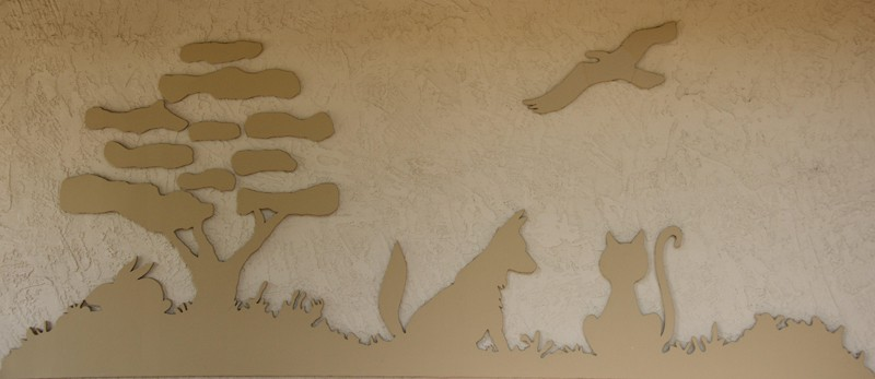 A wood cut out of the High Valley Veterinary Hospital logo